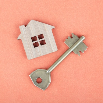 Decorative wooden symbol of a house with a key