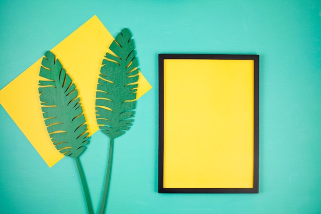 Decorative wooden tropical leaves and empty frame