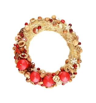 Decorative wreath with red christmas candles isolated on white