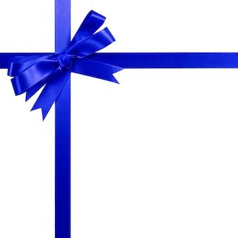 深い青色のギフトリボン弓垂直上隅枠白で隔離。