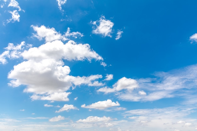 Deep blue sunny sky with white clouds.