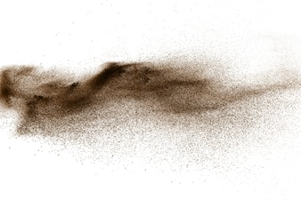 Deep Brown particles splattered on white background. Brown dust splash.