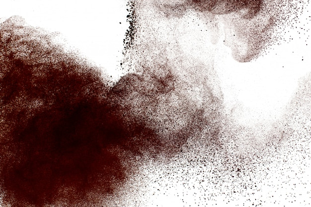 Deep brown powder dust explosion on white background.