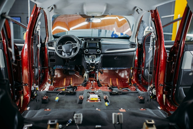 Deep car tuning, disassembled vehicle interior closeup, nobody. auto detailing. automobile in garage, no brand
