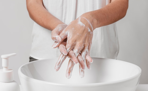 Deep cleaning the hands with water and soap