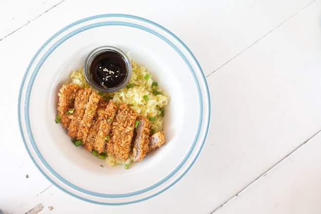 Deep fried breaded pork topped on rice with sesami, japanese food call