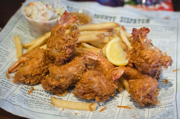 Deep fried bredded shrimps with french fries