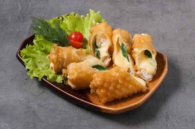 Deep-fried chicken, mozzarella and green onion rolls