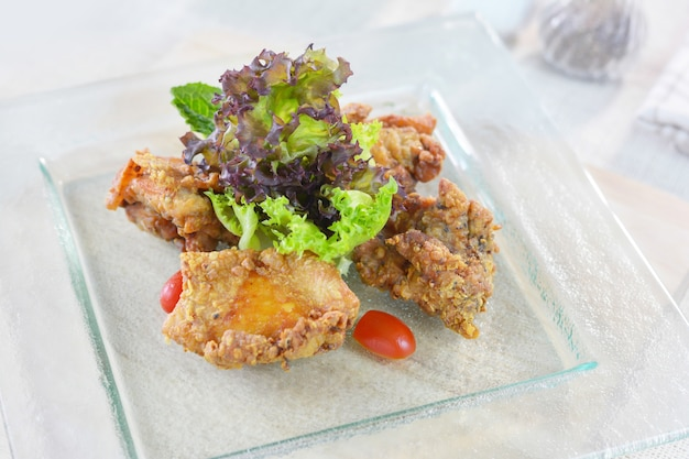 Deep fried chicken with soy sauce on glass plate