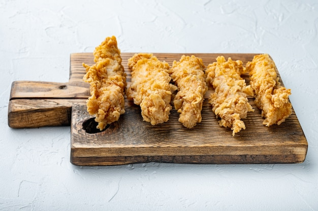 Deep fried crunchy spicy chicken meat on white
