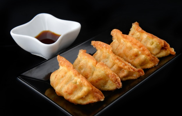 Deep fried gyoza crispy and golden colour.