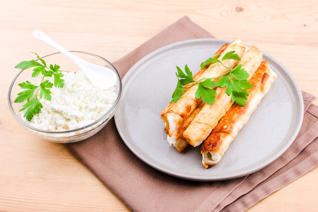 Deep fried pies with cottage cheese and parsley.