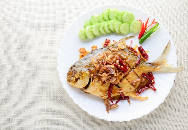 Deep fried pomfret with black pepper garlic, quick and easy dish.