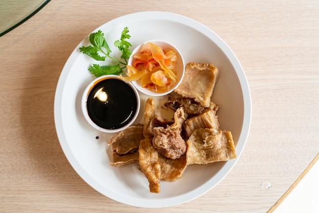 Deep fried pork intestines with sweet black sauce - asian food style