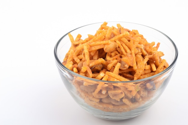 Deep fried salty dish - chivda or mixture made of gram flour and mixed with dry fruits.