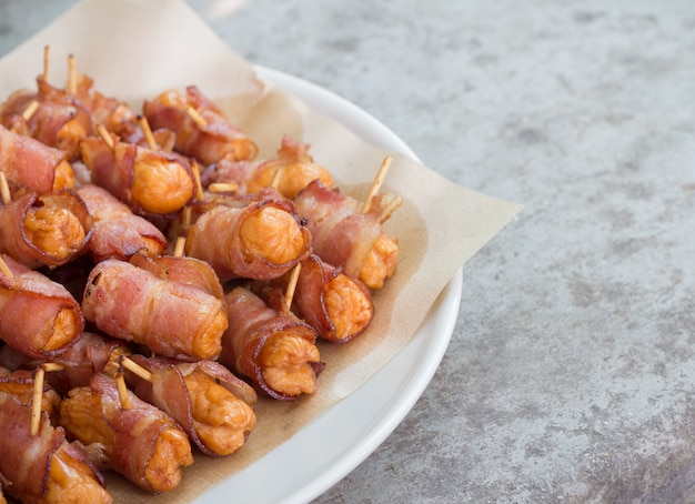 Deep fried sausages rolled in bacon