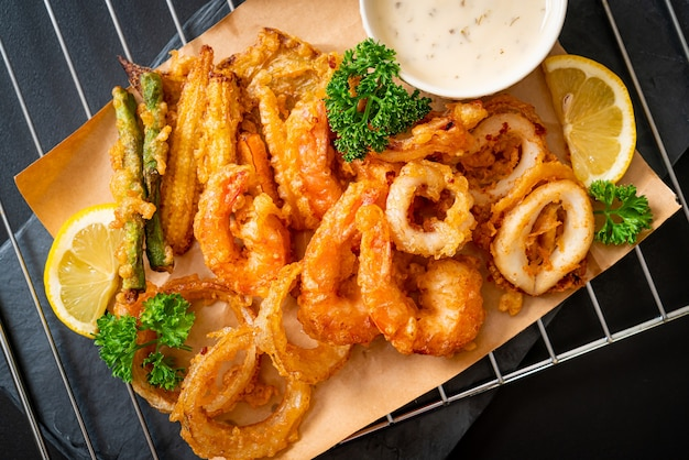 Deep fried seafood (shrimps and squid) with mix vegetable, unhealthy food style