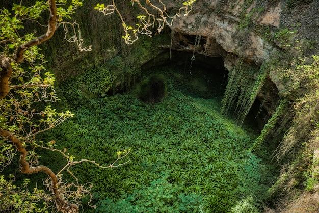 Deep natural sink hole in grisel, aragon, spain.