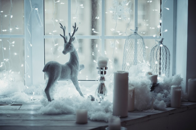 Deer figure standing at window christmas decor