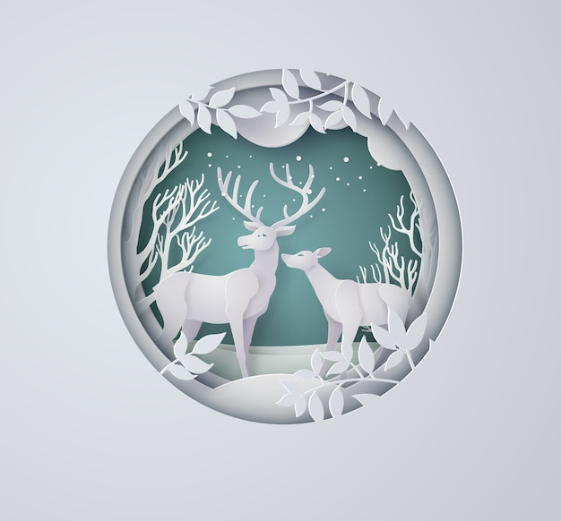 Deer in forest with snow in the winter season and christmas. paper art style.