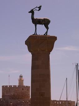 Deer statue at mandraki harbour in rhodes greece