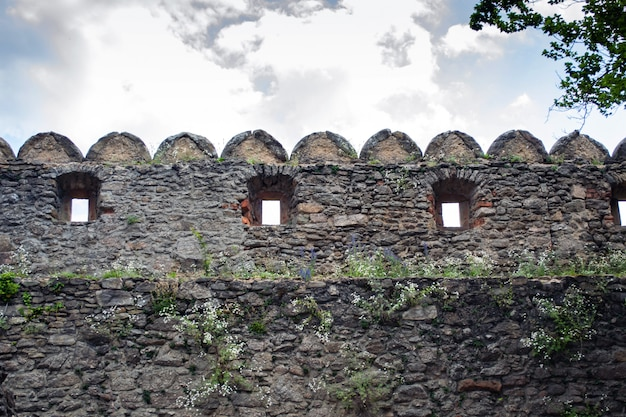 Defensive walls and fortifications of a medieval castle.