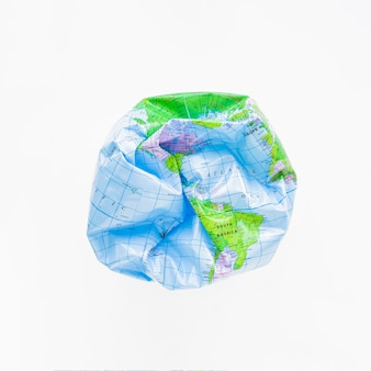 Deflated ball with earth map