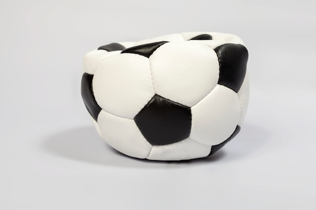 Deflated classic leather soccer ball