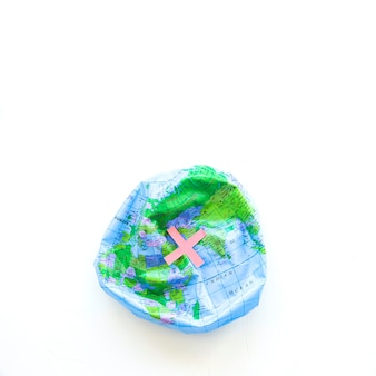 Deflated earth ball and cross