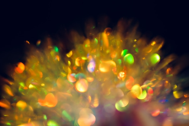 Defocus christmas colored bokeh is on the black background