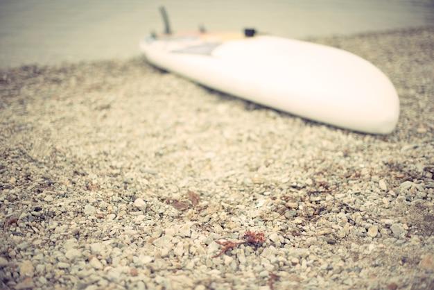 Defocus sap board lies beach seashore summer landscape monochrome water pebble