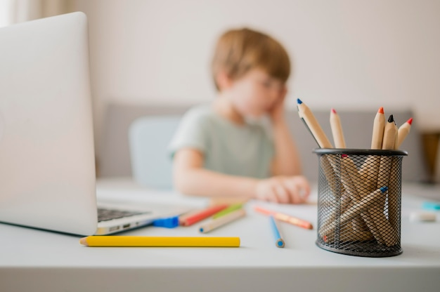 Defocused child at home learning