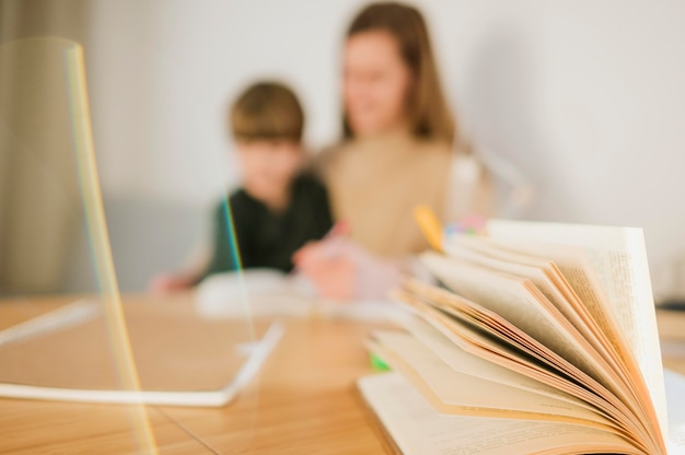Defocused child and tutor at home