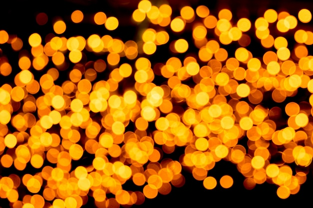 Defocused city gold night bokeh abstract background.