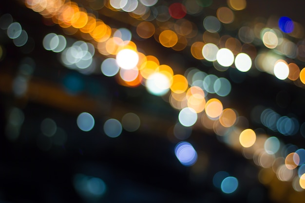 Defocused city night filtered bokeh abstract background.