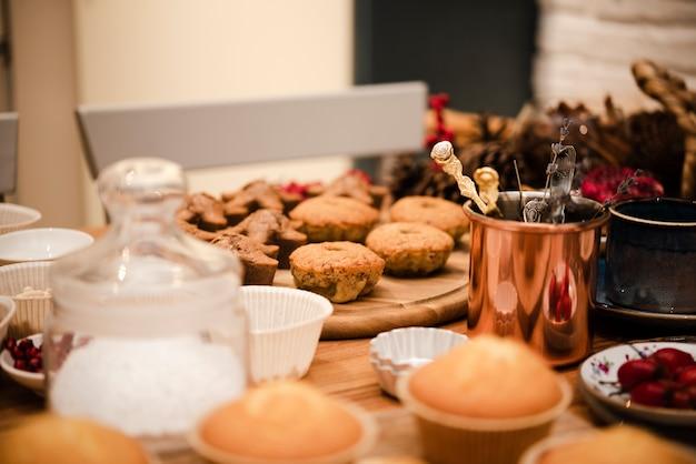 Defocused cupcakes with powdered sugar in jar