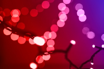 Defocused fairy lights on red