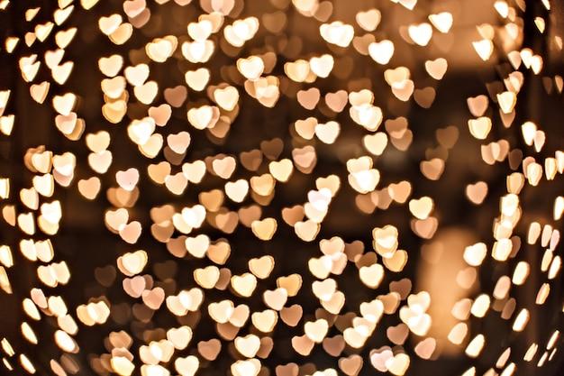Defocused gold heart in technique bokeh