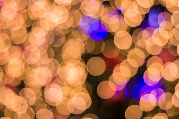 Defocused ligths of golden christmas tree background