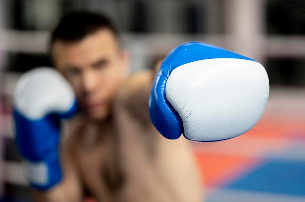 Defocused male boxer with protective gloves