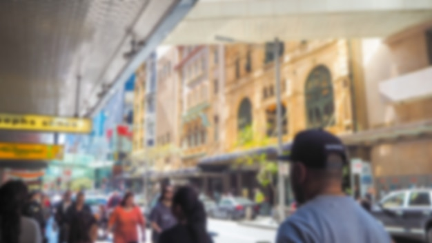Defocused photo of a street with people