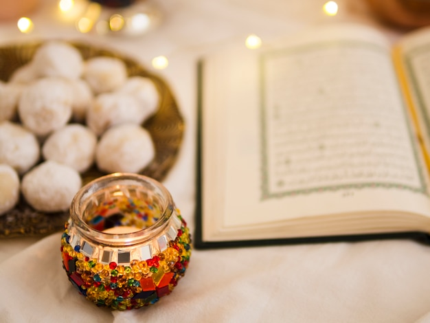Defocused quran and pastries arrangement