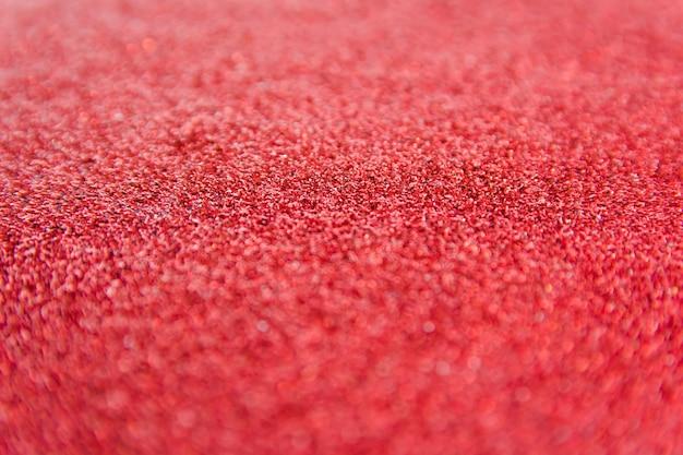 Defocused red glitter background