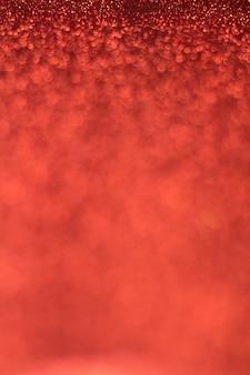 Defocused 빨간색 반짝이 사진. 추상 bokeh 효과.