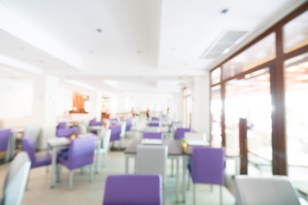 Defocused restaurant with purple chairs
