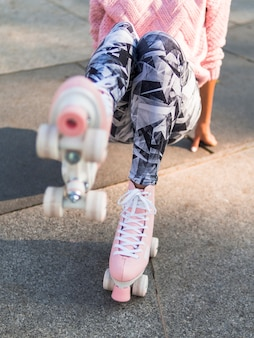 Defocused roller skates on woman with leggings