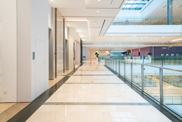 Defocused shopping mall in department store interior for background