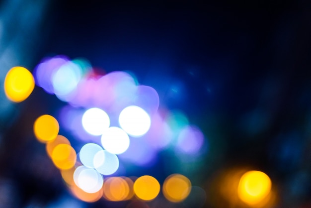 Defocused urban night background with colorful circles.