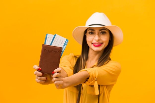 Defocused woman holding passport and plane tickets
