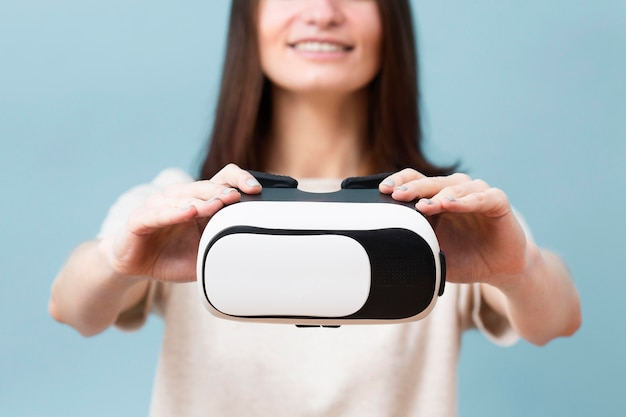 Defocused woman holding virtual reality headset